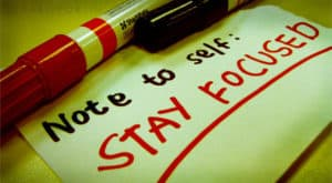 """Note to Self written in black and red marker: """"Stay Focused"""""""